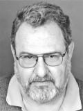 John Milius profil resmi